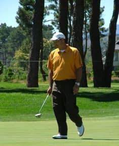 Ryan Dreyer eyes out his putt on the last hole