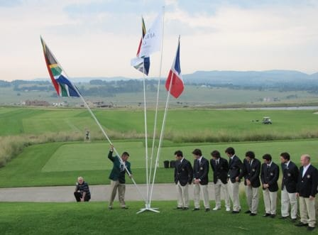 Ryan Dryer, SA Team Captain, places the South African Flag while the French team look on during an opening ceremony at Gardener Ross