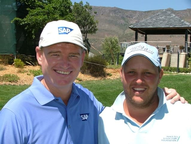 Ernie Els and Adrian Ford after their practice round yesterday