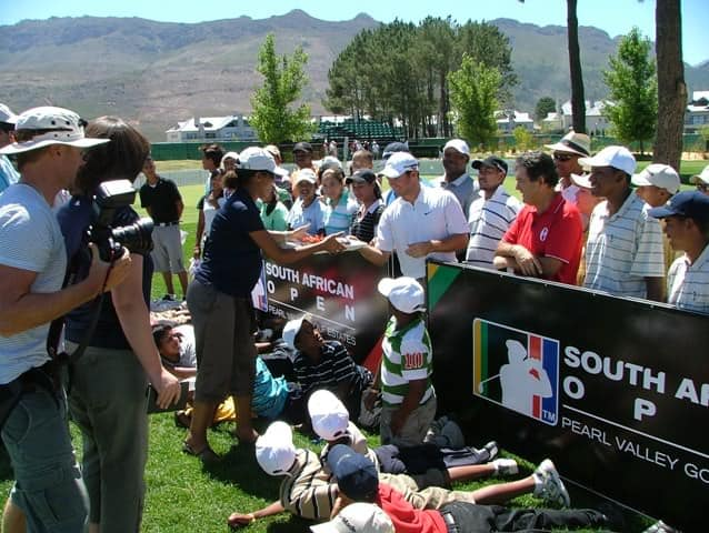 Immelman, Goosen and Frost (centre) surrounded by development golfers - Immelman receiving his surprise birthday cake
