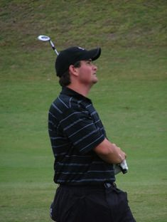 Jared Harvey (KZN) watches his second shot anxiously on 17th fairway