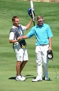 JG Claassen shakes the hand of his caddie JP Lombard on conclusion of his final round