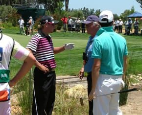 Claassen talks to rules official Thomas Waldenstedt about his lost ball on hole 12. He went on to record a triple bogey.