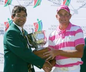 Enver Hassen, SAGA President, presents the trophy to JG Claassen winner of the SA Stroke Play Championship