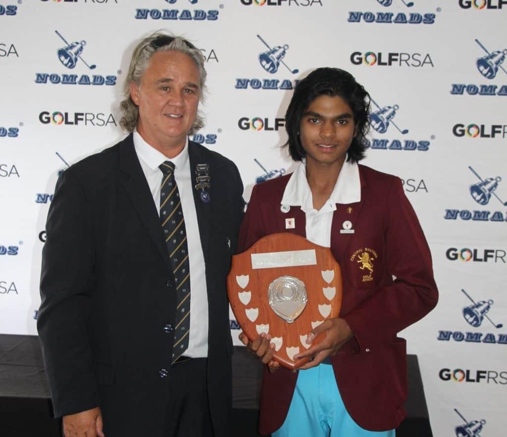 2019 Nomads SA Boys Under-15 champion Amilkar Bhana receives the trophy from Spero Marinaki, Gauteng Nomads; credit Hardus van der Merwe.