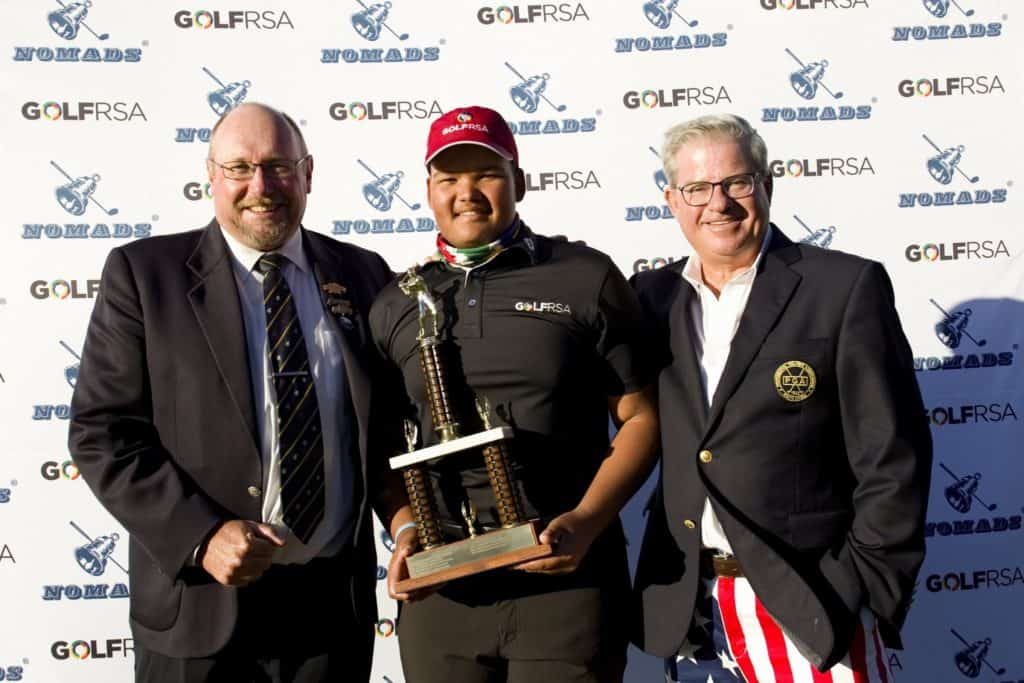 2019 Nomads SA Boys Under-17 champion Jordan Duminy receives the trophy from Nomads National Senior Vice National Chairman Stuart McIver and St Francis Links CEO Jeff Clause; credit Michael Sheehan.