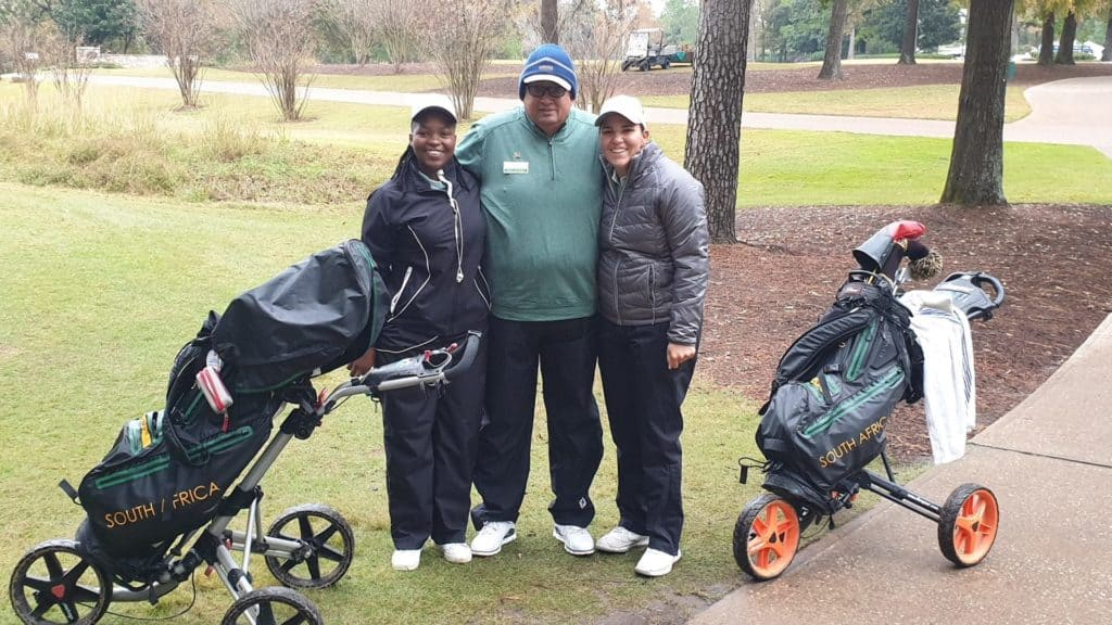 GolfRSA Proteas Zethu Myeki and Symone Henriques with South African Golf Association President Naadir Agherdien on day two of the Spirit International at Whispering Pines Golf Club; credit GolfRSA.