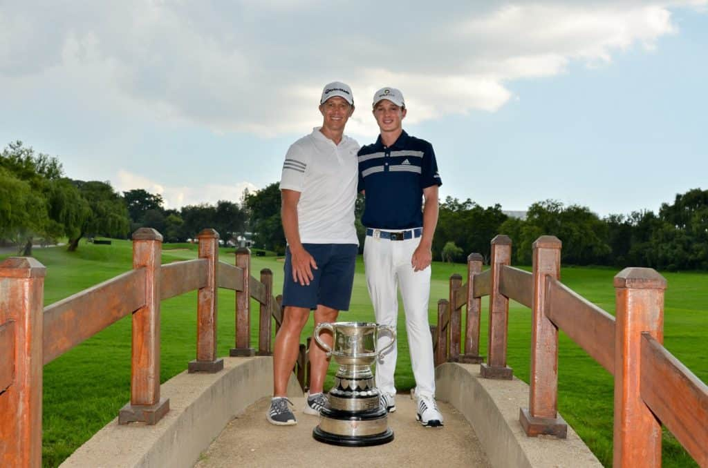 2.Jayden Schaper celebrates his Freddie Tait Cup victory with caddie – and dad - Ryan at the 2020 SA Open hosted by the City of Joburg at Randpark Golf Club; credit Ernest Blignault.