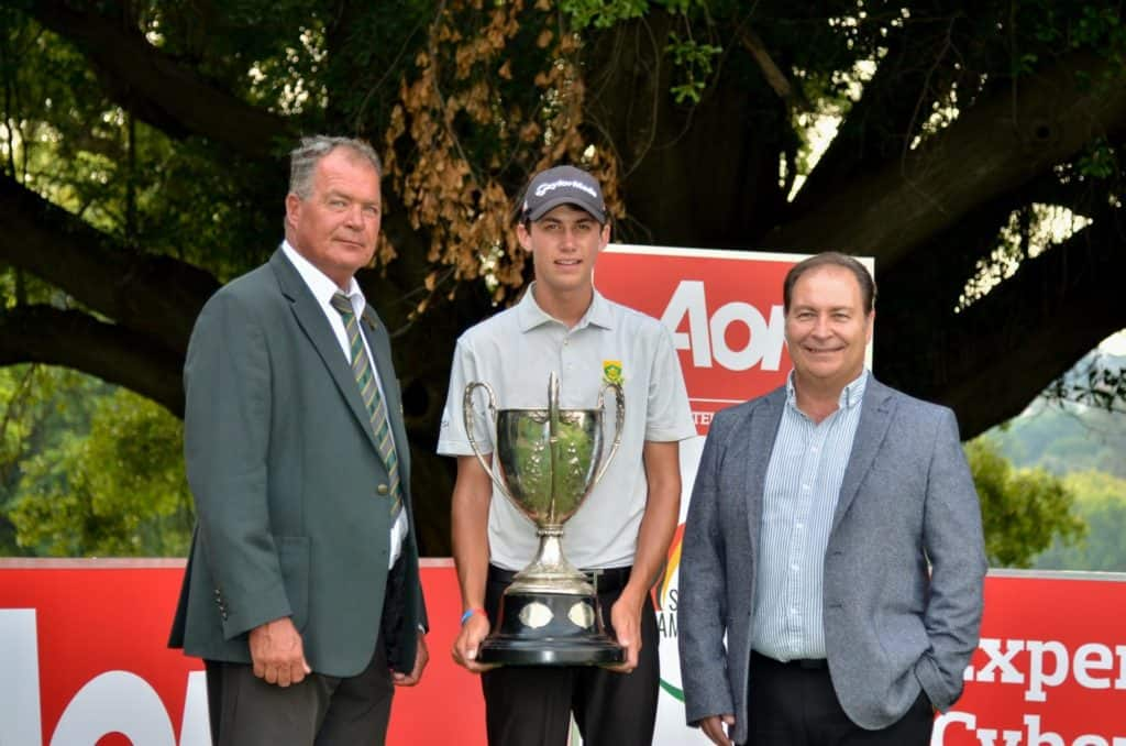Aon South African Amateur Championship 36-hole Stroke Play qualifier winner Sam Simpson receives the Proudfoot Trophy from South African Golf Association Vice-President Martin Saaiman (left) and Aon South Africa Regional Manager Commercial Risk Solutions Jacques de Villiers, credit Ernest Blignault.