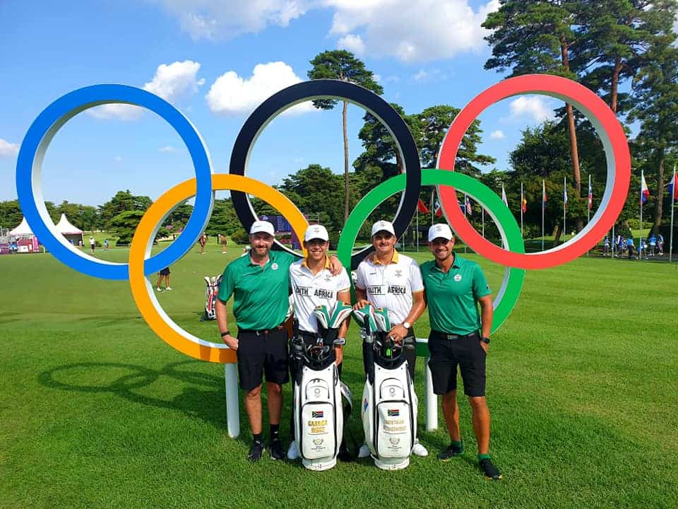 Team South Africa's Garrick Higgo and Christiaan Bezuidenhout with their caddies at the 2020 Olympic Games in Tokyo